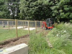 Digging Trench for Fox Proofing Wire